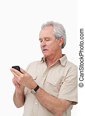 Mature man typing text message on his cellphone