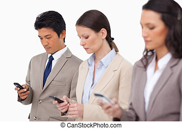 Young business team with their cellphones against a white...