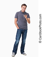 Young man holding his cellphone