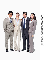 Smiling young salespeople standing together against a white...