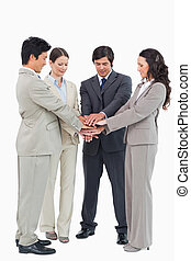 Business team performing self motivation ritual against a...