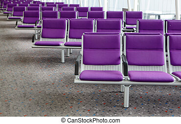 row of purple chair at airport