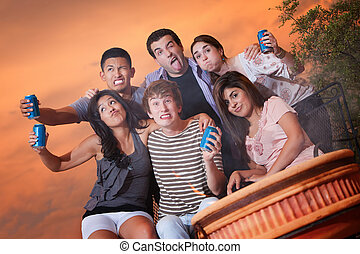 Funny Faces - Group of six friends with cans make funny...