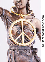 Lady Justice and a peace sign