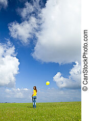 Girl with a balloon - Happy young woman with a yellow...