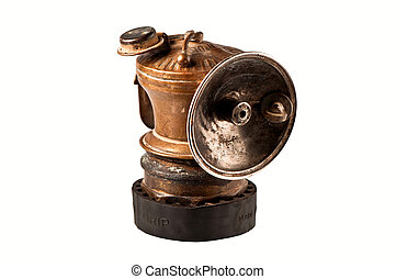 Antique gold miners lamp, isolated.