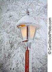 Streetlight in snow  v - Bright shining snowy street lamp