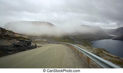 Mountain travel - Road mountain travel in Norway Fast motion...