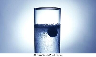 Dissolving pill - Pill dissolving in water.
