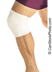 Athletic knee support - Leg of male athlete with bandaged...