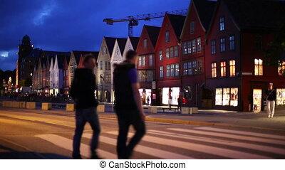 Bergen night - Bergen houses on quay. People walking on...