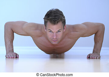 Man doing pushup - Topless male model performs pushup on...
