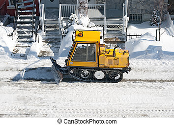 City street cleaned from snow by a snowplough