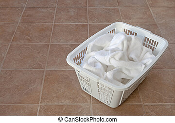 White towels in a laundry basket