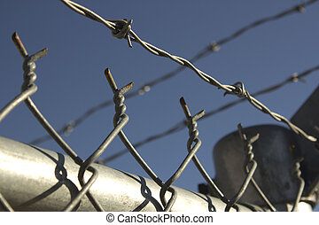 Barbed wire fence - barbed wire fence for security.
