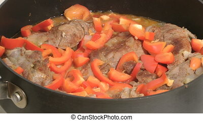 Stewed meat. - Stewed meat with red pepper.