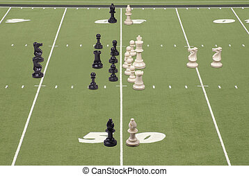Chess Football 50 Yard Line Play - Chess pieces lined up as...