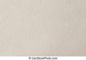 Cream textured paper closeup, can be used as a background.
