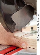 Labor safety - man cutting finger with power tool