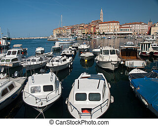 rovinj - city of Rovinj in Istria and boats in the harbour