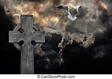 Graveyard cross with seagull against storm clouds -...
