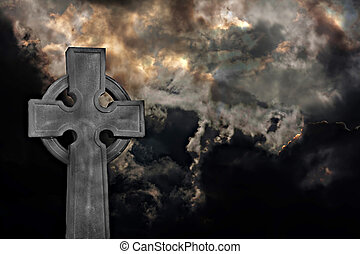 Graveyard cross against storm clouds - Graveyard cross...