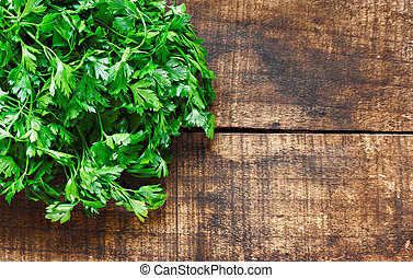 Fresh curly leaf parsley on rustin wooden background - Fresh...