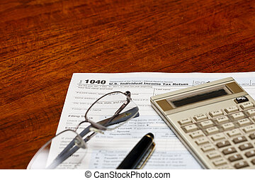 Tax Forms Pen Calculator and Glasses on Desk