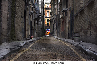Long dark cobbled back alley