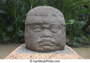 Olmec head - Giant statue of colossal Olmec head in Mexico