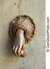 Rusted Hand Door Knocker - A mysterious hand comes out of...