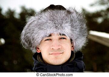 man in a fur cap