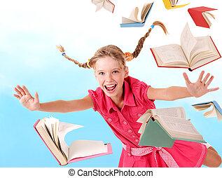 Schoolgirl holding pile of books. - School girl holding pile...
