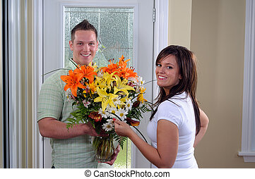 Fresh Flower Arrangement - Young Man Bringing His Girlfriend...