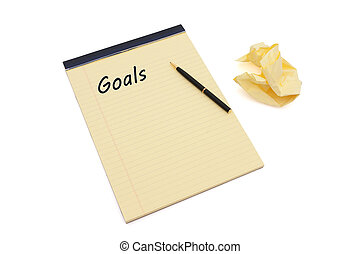 Writing your goals - Blank yellow lined notepad with...