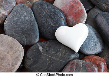 White heart surrounded by stones