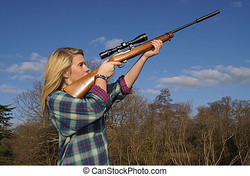 Girl Shooting Game with her Rifle - Girl out in the...