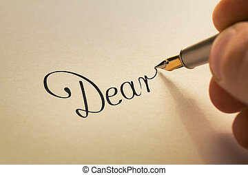 handwriting letter with pen - hand is writing calligraphic...