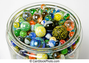 Jar of Marbles - A jar of beautiful glass marbles. There are...