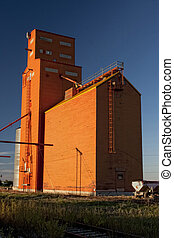 Orange Grain Elevator - Orange grain elevator stands tall on...