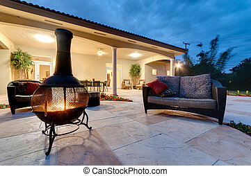 Backyard Fire Pit - Fire pit in a modern backyard with patio...