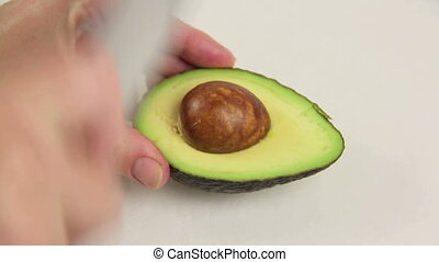 Seeding An Avocado - Close up of taking a seed out of an...