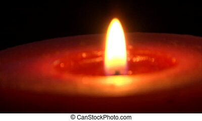 Candle CU - Focus Changes - Extreme close shot of a warm...