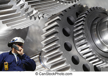 engineer, worker with giant gears - steel workers with giant...