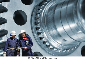 steel workers and machinery - workers, engineers with large...