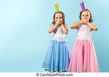 Astounded twins - Portrait of twin girls in beautiful...