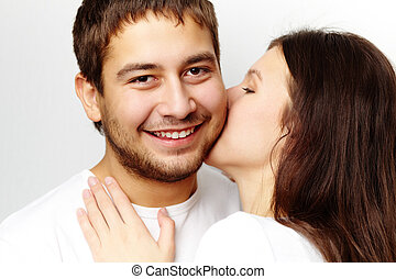 Proof of love - Happy girl kissing her boyfriend while he...