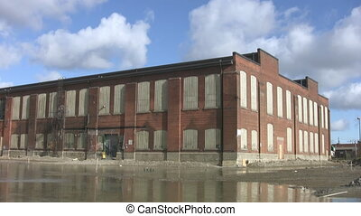 Abandoned Factory. Timelapse. - A large factory, boarded up...