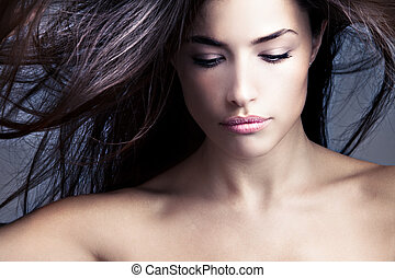 hair - young woman looking down with flying hair