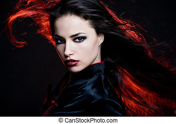 fire hair - beautiful dark hair woman with hair in motion...